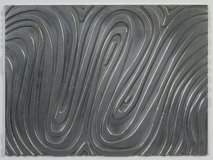 Sol LeWitt, W, 1995, machine milled aluminum plate, 8 ¾ x 11 ¾ inches (22.2 x 29.8 cm). Published by Two Palms, New York. © 2013 The LeWitt Estate / Artists Rights Society (ARS), New York / Photo: Ellen McDermott