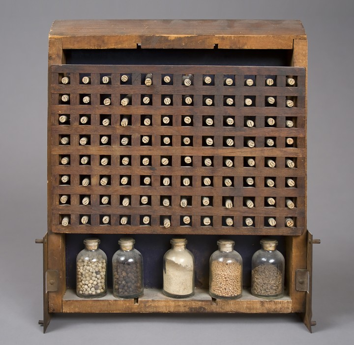 Lenore Tawney, Biblioteca Chemica, 1966, wood construction with metal, glass vials and seeds, 14 x 11 ¾ x 2 ⅞ inches (35.6 x 29.8 x 7.3 cm). © Lenore G. Tawney Foundation / Photo: Ellen McDermott